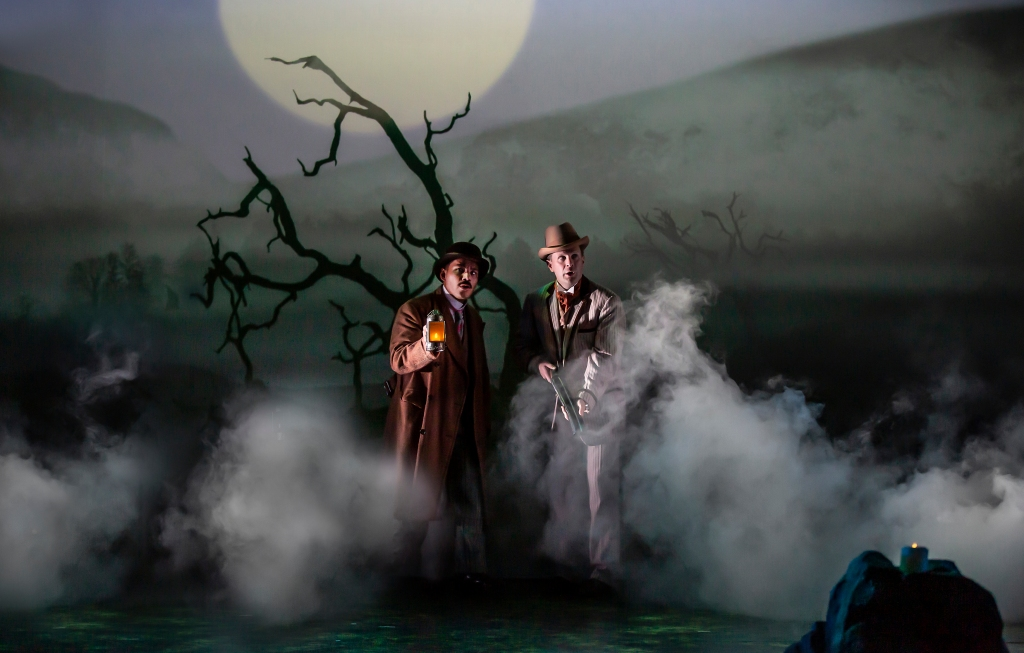 Imagine shows Holmes and Waston on the Baskerville moor at night with lanterns walking through the fog of the moors looking very alert!